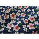 Tissu 100% coton bouquet sur fond bleu marine 150 cm de large