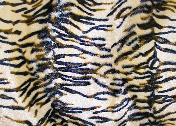 Tissu peau de b te fausse fourrure tigre largeur 140 cm - Tapis fausse fourrure pas cher ...